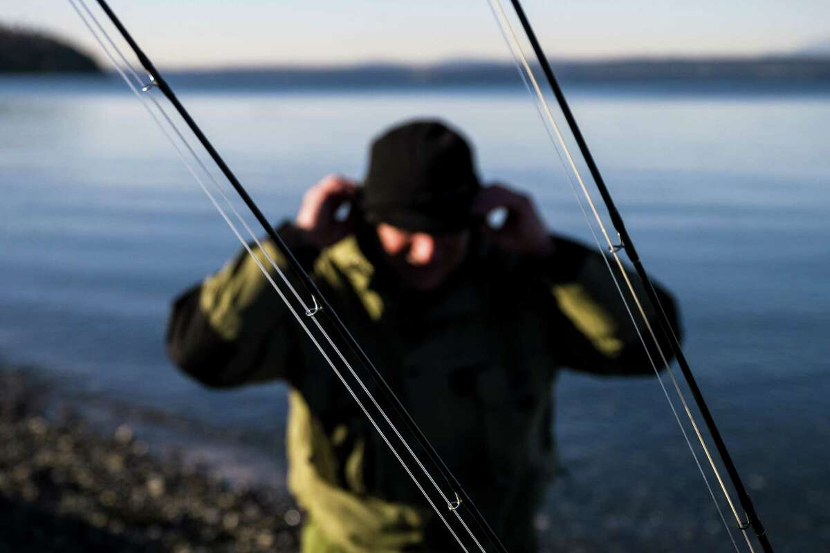 A fisherman prepares to spend the afternoon trying to catch a surge of chum salmon pouring into Piper's Creek Monday, November 17, 2014, in Carkeek Park in Seattle, Washington. Every 2-1/2 to 3-1/2 years at sea, the chum return. The mix of fish consist of releases of hatchery chum and from the natural spawning that now occurs in Piper's Creek. Historically, the best chum salmon viewing time is from the third week in November to the second week in December.