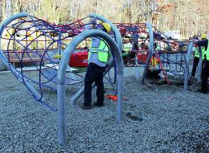 Workers installing the heart-shaped play piece custom made for the Healing Hearts Center for Grief and Loss last week. November 2014. Photo by Felicia Saraceno