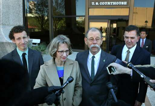 Mickey Redus, center right, and his wife Valerie Redus, center left, address the media outside the John Wood U.S. Courthouse, flanked by their son Kris Redus, left, and lawyer Brent C. Perry. The parents of Robert Cameron Redus, the slain student at University of the Incarnate Word, were in federal court in San Antonio for a hearing to determine if a lawsuit filed by lawyers of Valerie Redus and Mickey Redus, should stay in federal court or be sent back to state court.  Monday, Nov. 17, 2014. Photo: BOB OWEN, Staff / San Antonio Express-News / © 2014 San Antonio Express-News