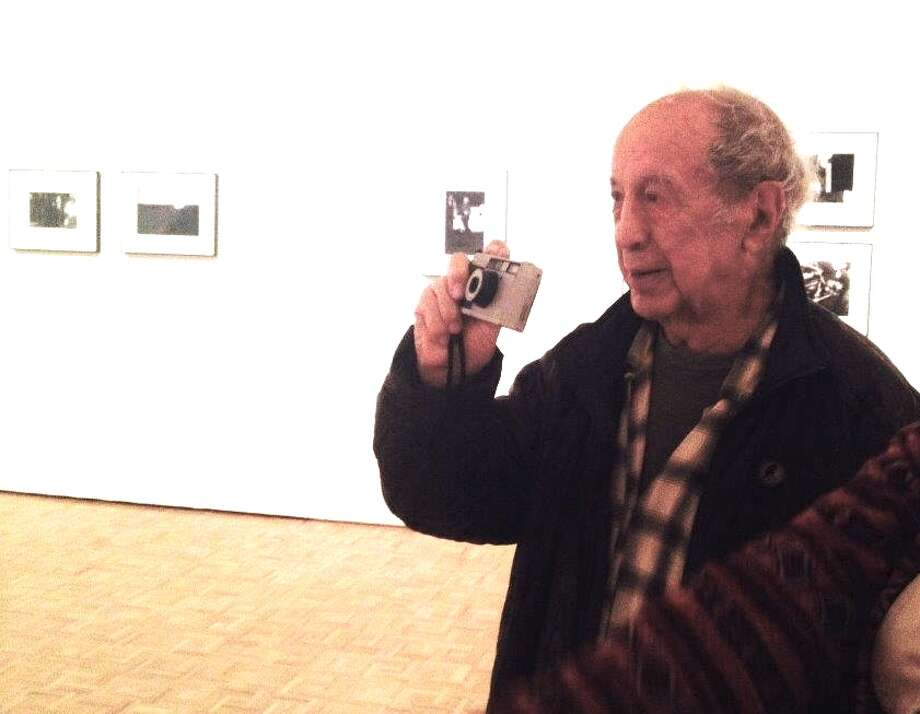 Robert Frank walks around gallery, snaps photos of his own photos