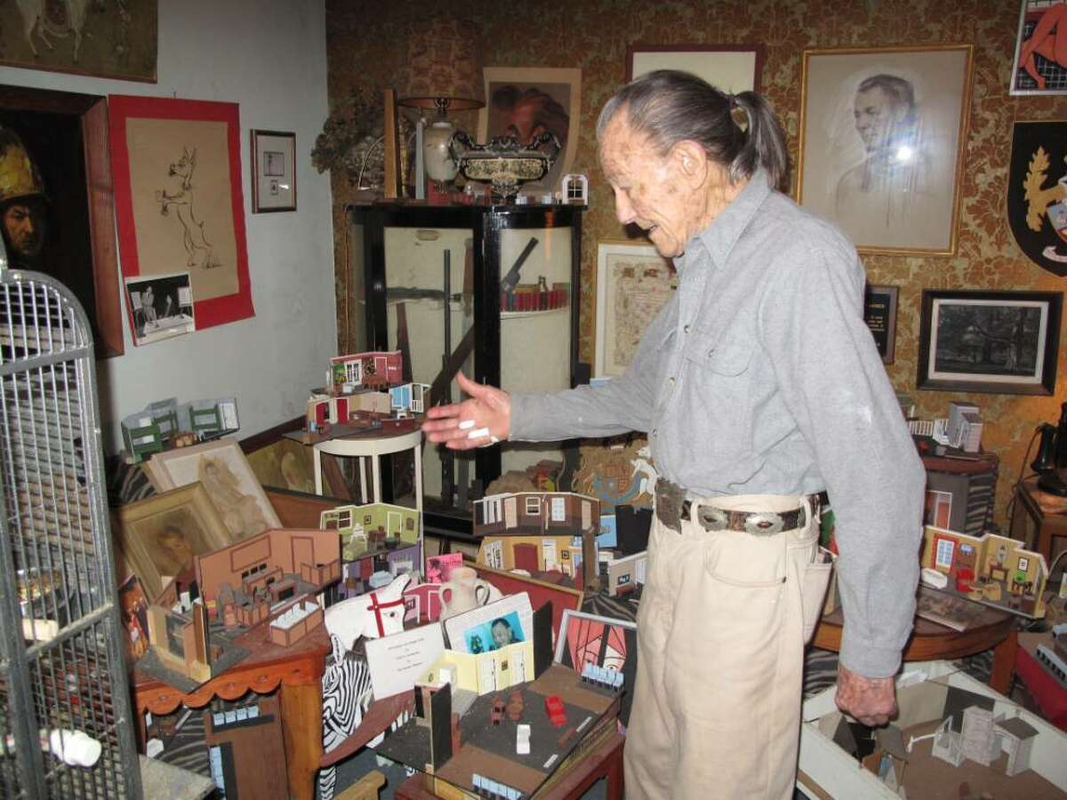 Fred Scharmer pionts out some of the miniature stage models he's created over the years.