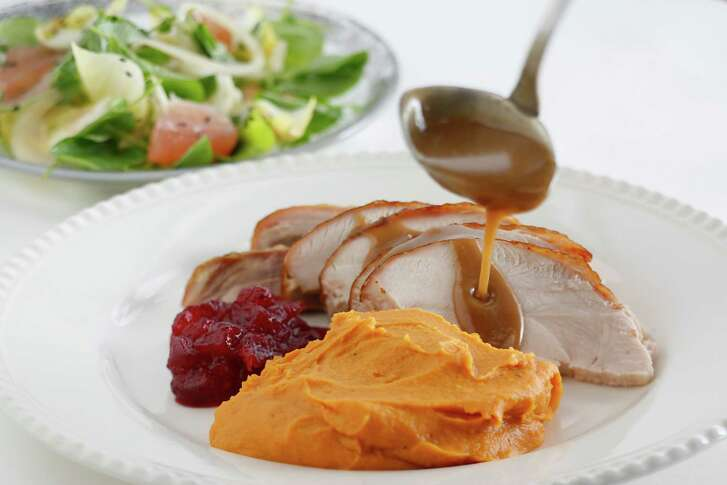 Roast turkey slices with gravy and sweet potato puree with brown sugar and cream.