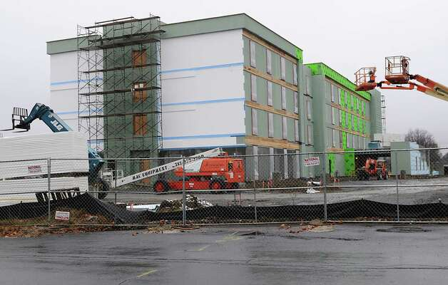 Construction is under way at Home2 Suites by Hilton on Metro Park Road  Monday, Nov. 17, 2014, in Colonie, N.Y.  (Lori Van Buren / Times Union) Photo: Lori Van Buren / 00029515A