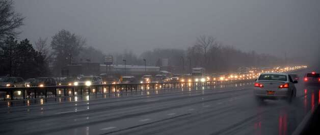 Cars off the road and inclement weather snarls traffic on I-87 southbound during rush hour Monday morning Nov. 17, 2014 in Clifton Park, N.Y.        (Skip Dickstein/Times Union) Photo: SKIP DICKSTEIN