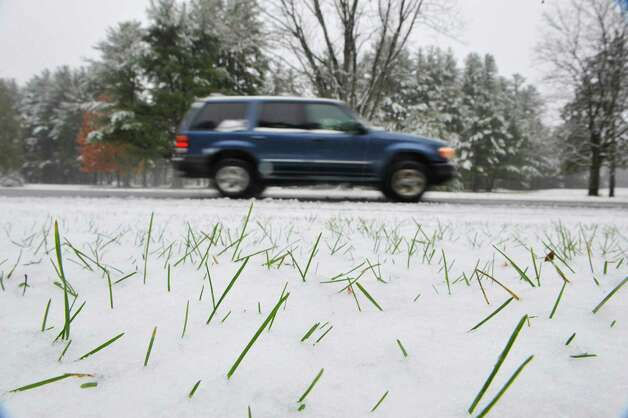 Fresh snow partially covers the grass in Saratoga Spa State Park on Monday morning, Nov. 17, 2014, in Saratoga Springs, N.Y.   (Paul Buckowski / Times Union) Photo: Paul Buckowski / 00029520A