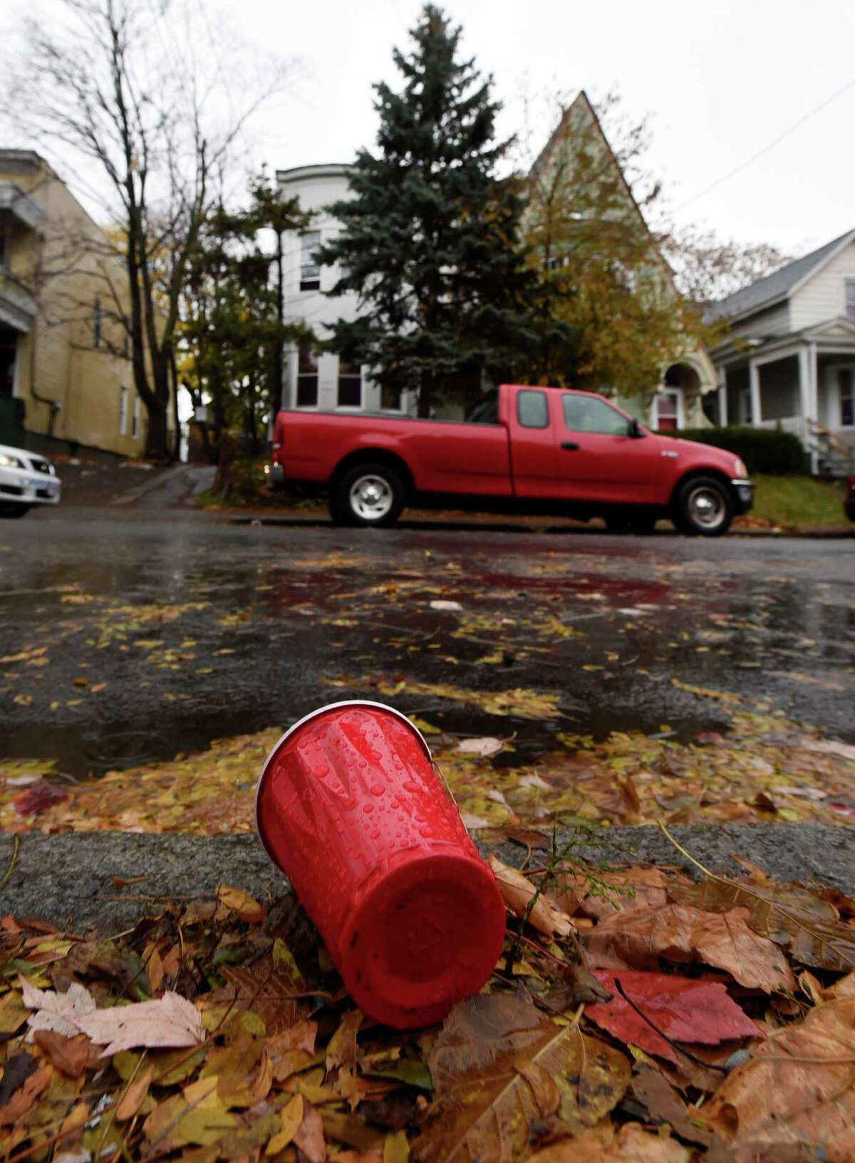 A red plastic cup litters the street across from 461 Hamilton Street at the scene of an alleged underage drinking party Monday afternoon, Nov. 17, 2014, in Albany, N.Y. Police responded to a call early Sunday morning and found five intoxicated 19-year-old men, all University at Albany students. One of them, Trevor Duffy, 19, of Bronx, died Monday at Albany Medical Center after excessive alcohol consumption.The other students were treated and released from area hospitals. (Skip Dickstein/Times Union)