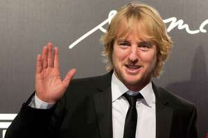 "FILE - In this Nov. 27, 2012 file photo, U.S. actor Owen Wilson poses for photos at the 2013 Pirelli Calendar red carpet event in Rio de Janeiro, Brazil. A fire broke out on the set of Hollywood movie ""The Coup"" starring Wilson and Lake Bell, both of whom had already left for the day and were unharmed, the local production company said Thursday, Nov. 21, 2013. The film about an American family that gets caught in the middle of a military coup in Southeast Asia is on location in northern Thailand. (AP Photo/Felipe Dana, File) ORG XMIT: TOK102"