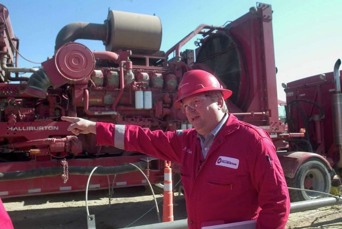 Halliburton personnel such as technology director Ron Hyden, shown in 2010 at the firm's well site near Poth, will work for a company with the same name but many more assets after the merger with Baker Hughes.