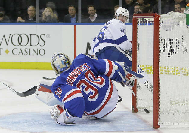 Tampa Bay Lightning's Nikita Kucherov (86), of Russia, scores on New York Rangers goalie Henrik Lundqvist (30), of Sweden, during the first period of an NHL hockey  game Monday, Nov. 17, 2014, in New York. (AP Photo/Frank Franklin II) ORG XMIT: MSG102 Photo: Frank Franklin II / AP