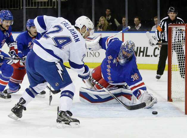 Tampa Bay Lightning's Ryan Callahan (24) shoots the puck past New York Rangers' Henrik Lundqvist (30), of Sweden, during the first period of an NHL hockey game Monday, Nov. 17, 2014, in New York. (AP Photo/Frank Franklin II) ORG XMIT: MSG105 Photo: Frank Franklin II / AP