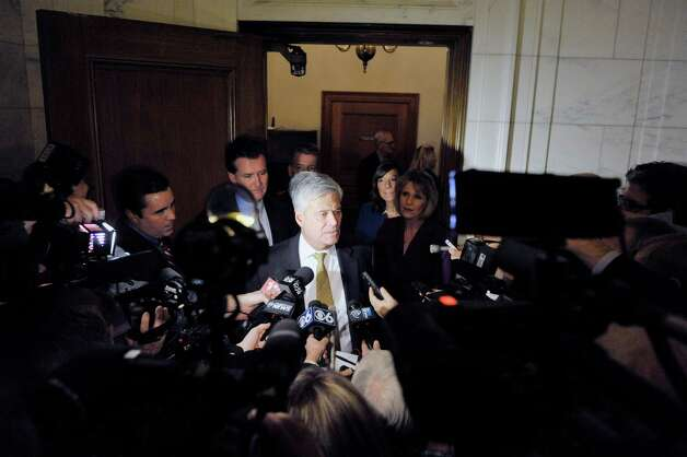 Senate Majority Leader Dean Skelos talks to members of the media outside his office following a meeting of Senate Republican on Monday, Nov. 17, 2014, in Albany, N.Y.   (Paul Buckowski / Times Union) Photo: Paul Buckowski / 00029519A