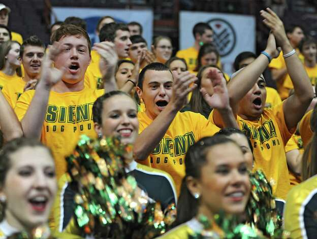 Siena fans cheer for their team during a basketball game against Vermont at the Times Union Center on Monday, Nov. 17, 2014 in Albany, N.Y.  (Lori Van Buren / Times Union) Photo: Lori Van Buren / 00029488A