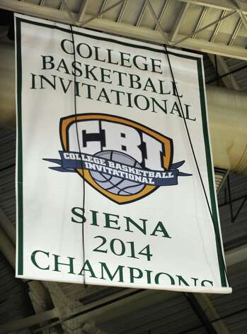 A Siena banner is unveiled before a basketball game against Vermont at the Times Union Center on Monday, Nov. 17, 2014 in Albany, N.Y.  (Lori Van Buren / Times Union) Photo: Lori Van Buren / 00029488A