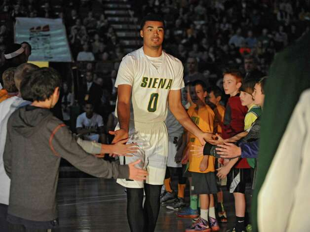 Siena fans cheer as Javion Ogunyemi is introduced before a basketball game against Vermont at the Times Union Center on Monday, Nov. 17, 2014 in Albany, N.Y.  (Lori Van Buren / Times Union) Photo: Lori Van Buren / 00029488A