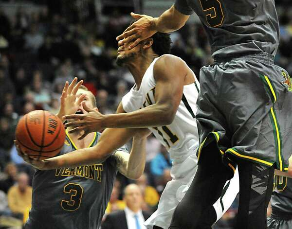 Siena's Patrick Cole is fouled by Vermont's Hector Herold during a basketball game at the Times Union Center on Monday, Nov. 17, 2014 in Albany, N.Y.  (Lori Van Buren / Times Union) Photo: Lori Van Buren / 00029488A