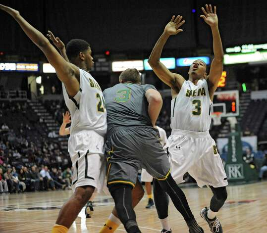 Siena's Ryan Oliver, right, fouls Vermonts Ryan Pierson as he and Lavon Long double team him in an aggressive full court press during a basketball game at the Times Union Center on Monday, Nov. 17, 2014 in Albany, N.Y.  (Lori Van Buren / Times Union) Photo: Lori Van Buren / 00029488A