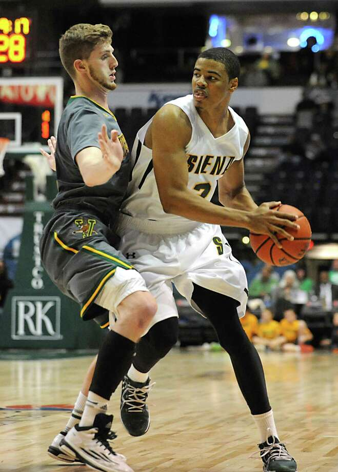 Siena's Ryan Oliver is guarded by Vermont's Brendan Kilpatrick during a basketball game at the Times Union Center on Monday, Nov. 17, 2014 in Albany, N.Y.  (Lori Van Buren / Times Union) Photo: Lori Van Buren / 00029488A