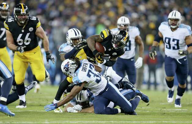 NASHVILLE, TN - NOVEMBER 17:   Michael Griffin #33 of the Tennessee Titans tackles Le'Veon Bell #26 of the Pittsburgh Steelers in the first quarter of the game at LP Field on November 17, 2014 in Nashville, Tennessee.  (Photo by Andy Lyons/Getty Images) ORG XMIT: 507883455 Photo: Andy Lyons / 2014 Getty Images