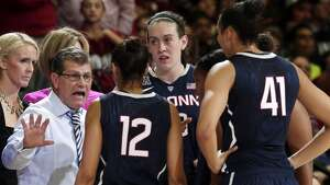Connecticut head coach Geno Auriemma gathers his team in the closing minutes of a 88-86 overtime loss to Stanford in an NCAA college basketball game on Monday, Nov. 17, 2014, in Stanford, Calif. (AP Photo/Marcio Jose Sanchez)