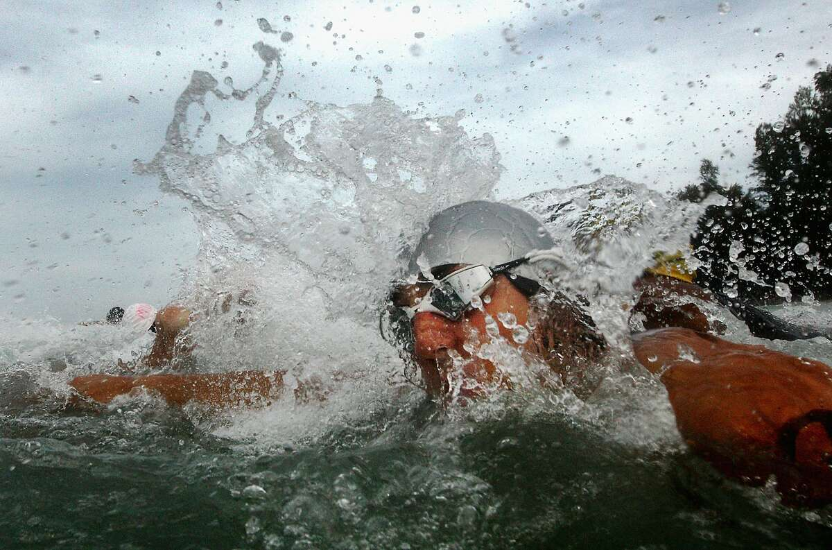 PHUKET, THAILAND - NOVEMBER 17: Competitors dive into the water for the start of the Men's triathlon during the 2014 Asian Beach Games at Nai Yang Beach on November 17, 2014 in Phuket, Thailand. (Photo by Quinn Rooney/Getty Images) *** BESTPIX ***