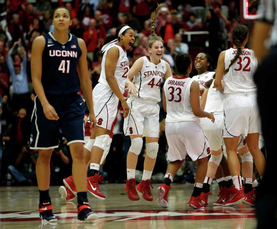 Stanford players celebrate their 88-86 overtime win over No. 1 Connecticut, to the dismay of the Huskies' Kiah Stokes. Photo: Scott Strazzante / The Chronicle / ONLINE_YES