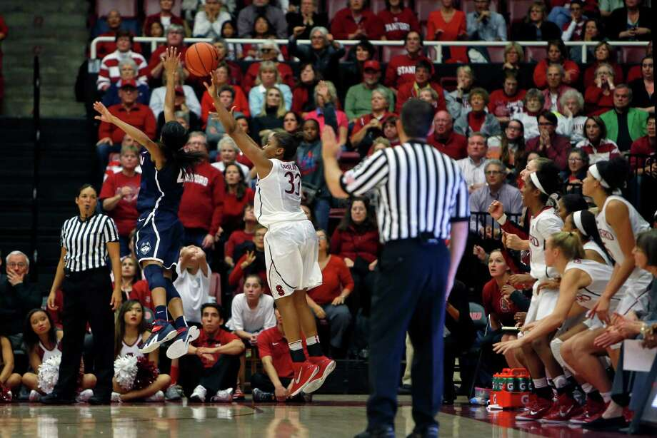 Amber Orrange fires a three-pointer with 1.4 seconds left in regulation Nov. 17 to force overtime, in which Stanford completed its upset of No. 1 Connecticut. Photo: Scott Strazzante / The Chronicle / ONLINE_YES