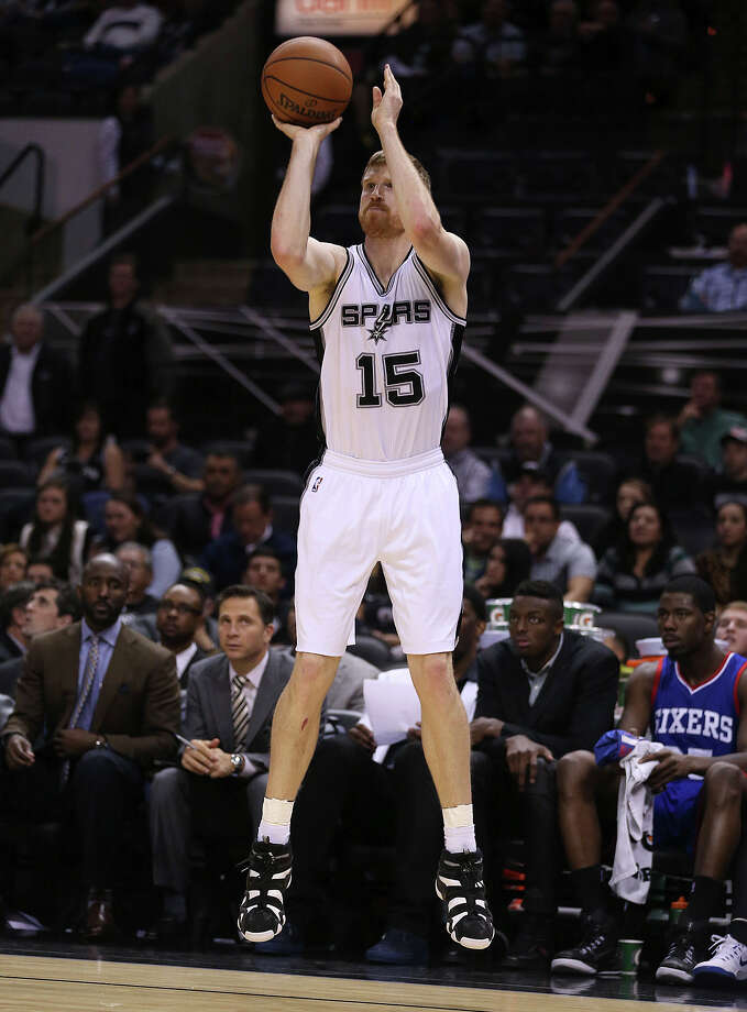 Matt Bonner shoots from behind the 3-point line against the 76ers. Bonner ended with the game high of 18 points. Photo: JERRY LARA, Staff / San Antonio Express-News / © 2014 San Antonio Express-News