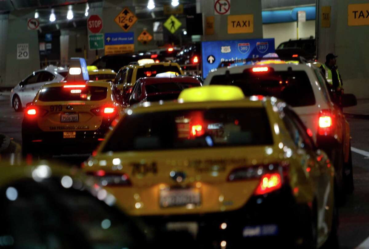 Taxi drivers clog traffic outside Terminal 1 during a protest at San Francisco International Airport on Nov. 17, 2014.