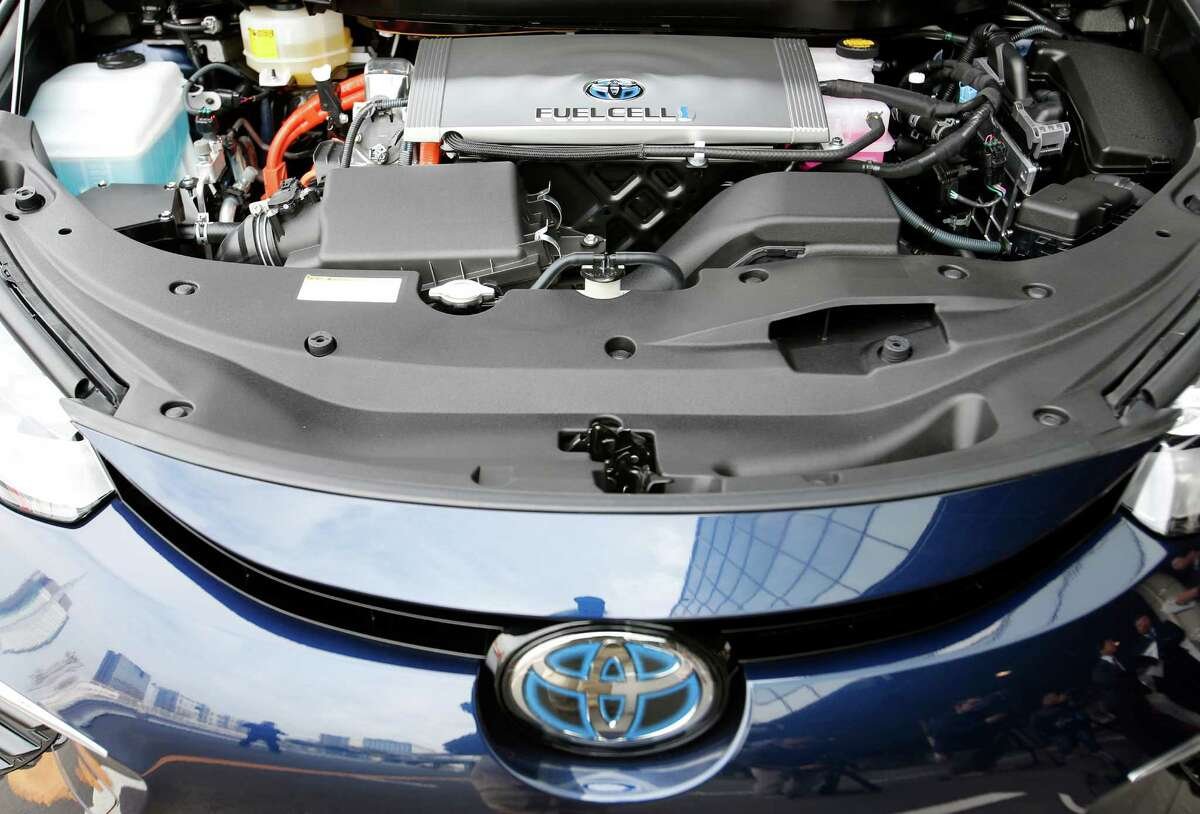 In this photo taken Monday, Nov. 17, 2014, the engine part of a Toyota Motor Corp.'s new fuel cell vehicle Mirai is shown at its showroom test course in Tokyo. There will only be a few hundred, and they won't be cheap, but Toyota is about to take its first small step into the unproven market for emissions-free, hydrogen-powered vehicles. The world's largest automaker announced Tuesday, Nov. 18 that it will begin selling fuel cell cars in Japan on Dec. 15 and in the U.S. and Europe in mid-2015. The sporty-looking, four-door Toyota Mirai will retail for 6.7 million yen ($57,600) before taxes.