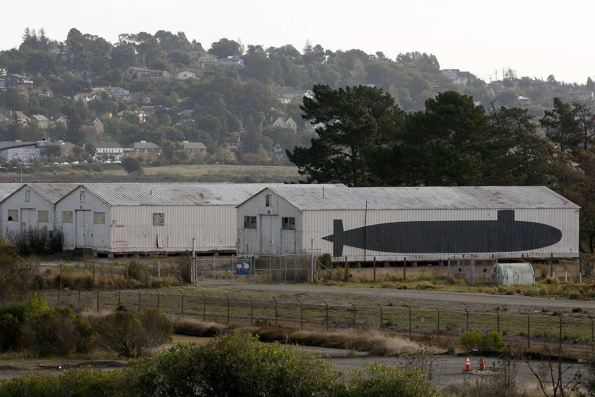A submarine painted on the side of an old building is seen on a disused 157-acre parcel of land on the northeast end of Mare Island on Saturday, November 15, 2014. The Koi Nation and the Elem Indian Colony have put forth competing plans to develop casinos on the parcel, which was formerly military land and is now owned by the city of Vallejo.