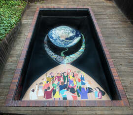 Patrick Gannon and his two sons Noah and Sean painted a drought-themed mural at the bottom of their swimming pool in Marin County.