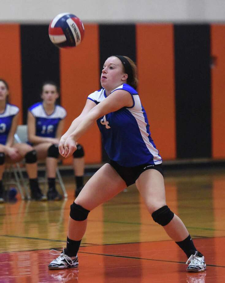 Ludlowe's Liz Buckley sets a ball for a return during action against Darien in the CIAC Class LL volleyball semifinals on November 13 in Shelton. The Falcons became just the second state team to take a set from the Blue Wave but Darien won the match 3-1, ending Ludlowe's season at 20-4. Photo: Tyler Sizemore / Greenwich Time