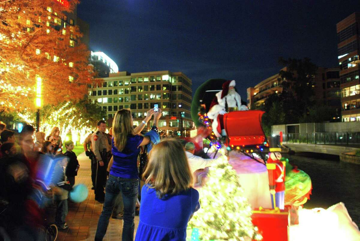 Santa Claus has arrived by boat to The Woodlands in past years, with his sleigh perched on top of a Waterway Cruiser that carried him to the annual Lighting of the Doves event.