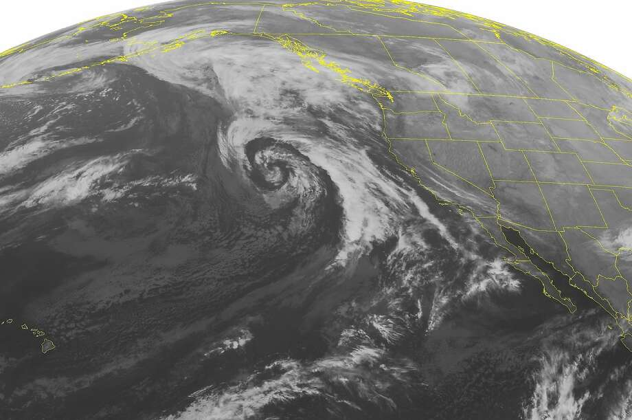 This NOAA satellite image taken Tuesday, Nov. 18, 2014, at 01:00 AM EST shows a few clouds over California as part of the front edges of an occluding Pacific Ocean low moving inland. Photo: Noaa, Associated Press