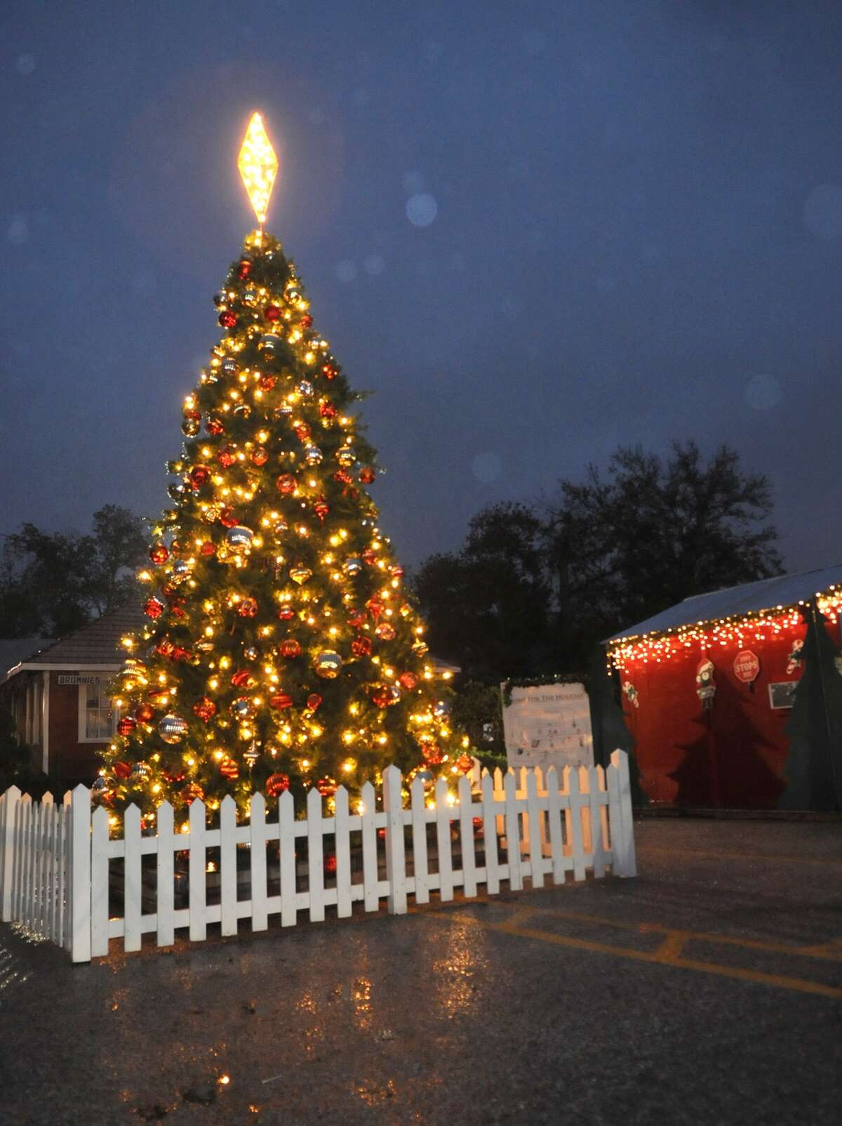 A 30-foot tall Christmas tree sits next to Santa's cabin in Santa's Village in Old Town Spring. The annual Home for the Holidays in Old Town Spring is under way every weekend between through Dec. 21. Family friendly activities, display of lights, trackless train rides, and photos with Santa are part of the activities.