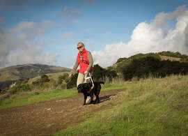 Theresa Stern of Guide Dogs for the Blind walks the trails with her guide dog, Dario.