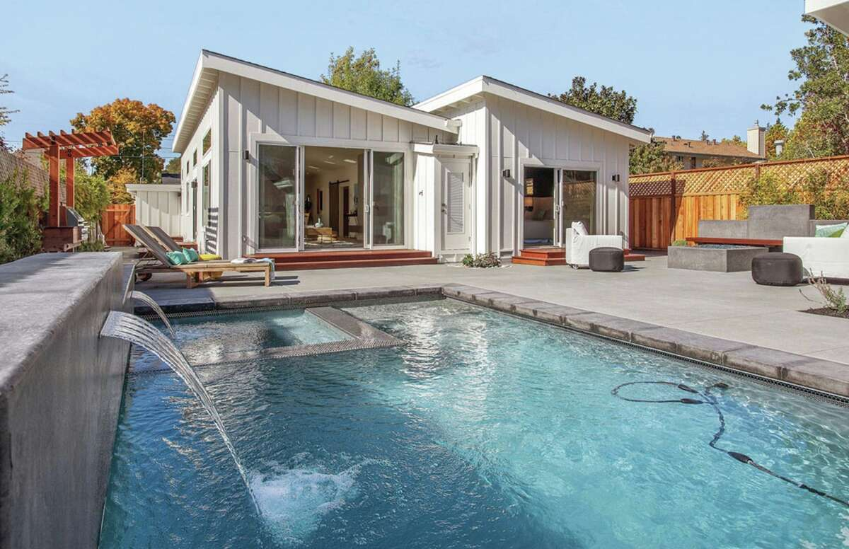 The backyard includes a pool with built-in spa and waterfalls.
