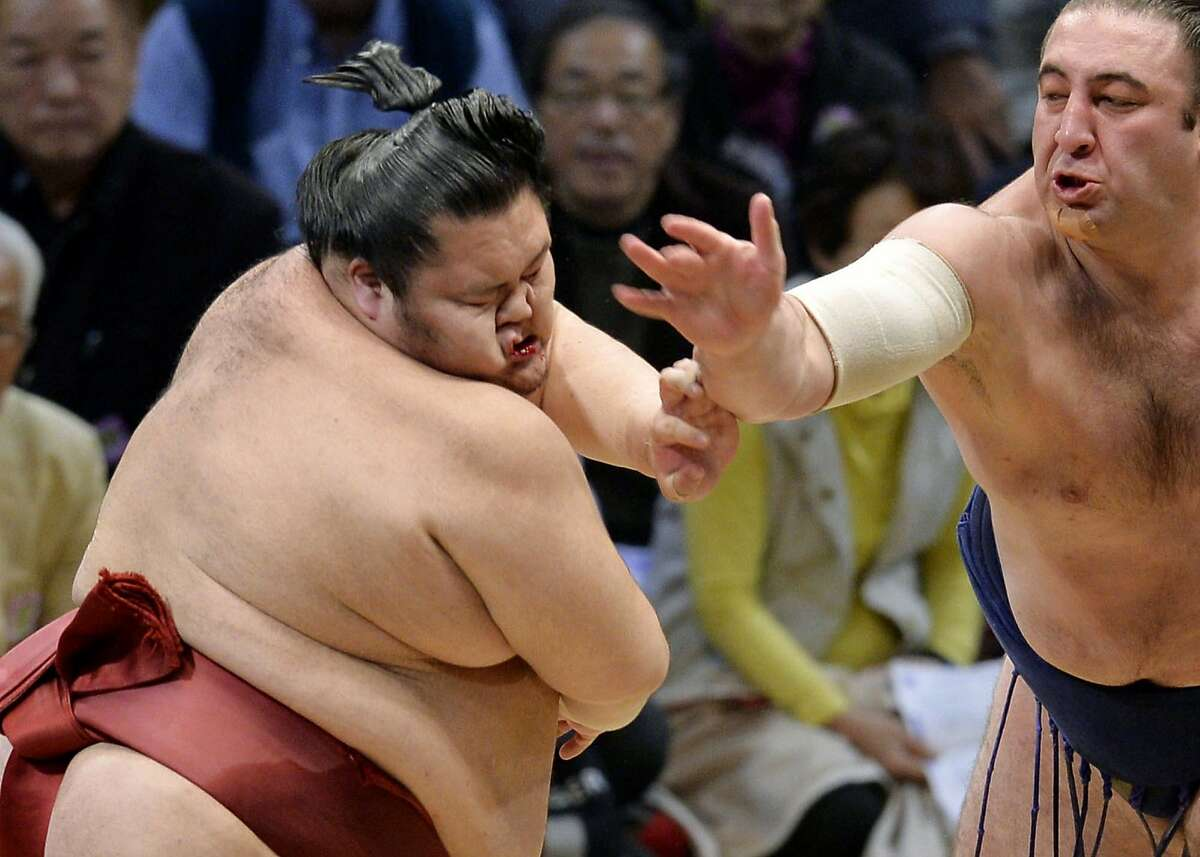 NOW YOU'VE GONE AND MADE HIM MAD: Georgian-born Tochinoshin slaps Chiyomaru in the face during their match in the Kyushu Grand Sumo Tournament in Fukuoka, Japan.