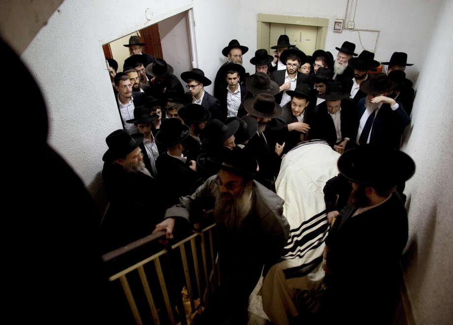 Ultra-Orthodox Jews carry the body of U.S.-born rabbi Moshe Twersky during a joint funeral for victims of the synagogue attack in Jerusalem. Photo: Oded Balilty / Associated Press / AP