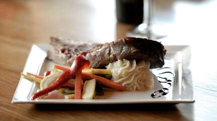 New York strip steak topped with a cabernet peppercorn sauce with mashed potatoes and fresh seasonal vegetables  prepared by Chef Rocco Selmanti of Portofino Restaurant & Wi