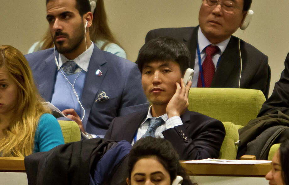 North Korean dissident Shin Dong-Hyuk, center, holds his ear-piece as he listens during a meeting of the U.N. General Assembly human rights committee on a proposal to refer North Korea to the International Criminal Court for alleged crimes against humanity, Tuesday, Nov. 18, 2014. A North Korean diplomat, foreign ministry adviser Kim Ju Song was witnessed trying to get a U.N. official to eject Shin Dong-Hyuk, who fled North Korea and has since spoken out against the government. (AP Photo/Bebeto Matthews) Photo: Bebeto Matthews / Associated Press / AP