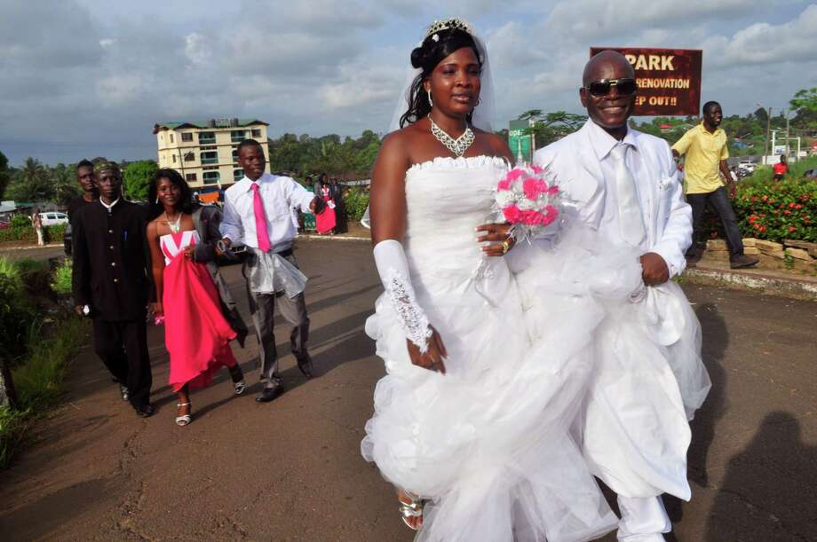 A just-married couple Sunday visit a park in Monrovia commonly used for wedding photography. Photo: Abbas Dulleh / Associated Press / AP