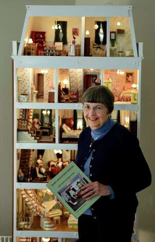 Mary Ann Styczynski stands by the dollhouse Nov. 10, 2014 that she built in her home Nov. 10, 2014 in Saratoga Springs, N.Y.    (Skip Dickstein/Times Union) Photo: SKIP DICKSTEIN / 00029401A