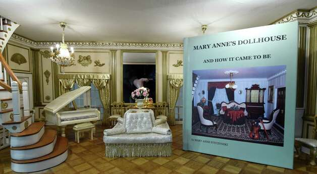 The book that was written by Mary Ann Styczynski is placed in the ballroom in the doll house she built while she was dealing with her daughter's illness as it sits in her home Nov. 10, 2014 in Saratoga Springs, N.Y.    (Skip Dickstein/Times Union) Photo: SKIP DICKSTEIN / 00029401A