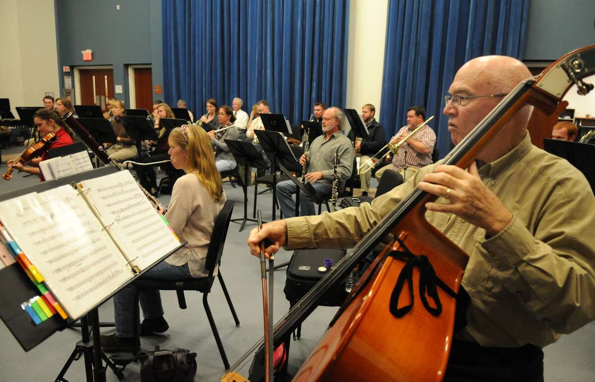 String Bass player Joe Moore, of Spring, and the Kingwood Pops Orchestra rehearse for their upcoming holiday show at Lone Star College - Kingwood.