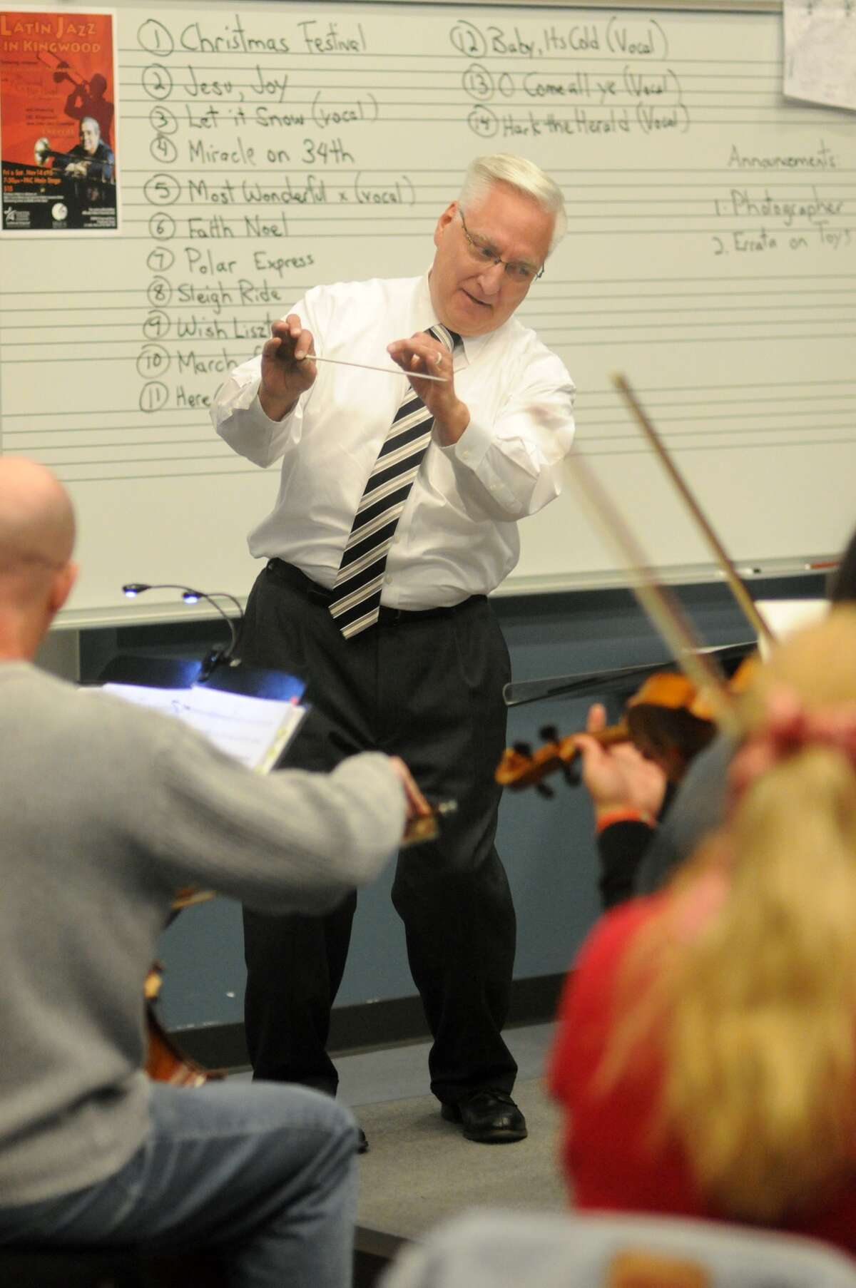 Conductor Gary Liebst, of Conroe, leads the Kingwood Pops Orchestra during their rehearsal for their upcoming holiday show at Lone Star College - Kingwood.