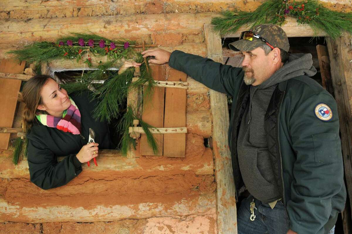 Rose Holmes, left, a Harris County Precinct 4 forester at Jesse H. Jones Park and Nature Center, and park historian Monte Parks decorate the historic Redbud Homestead for the park's upcoming holiday celebrations in December.
