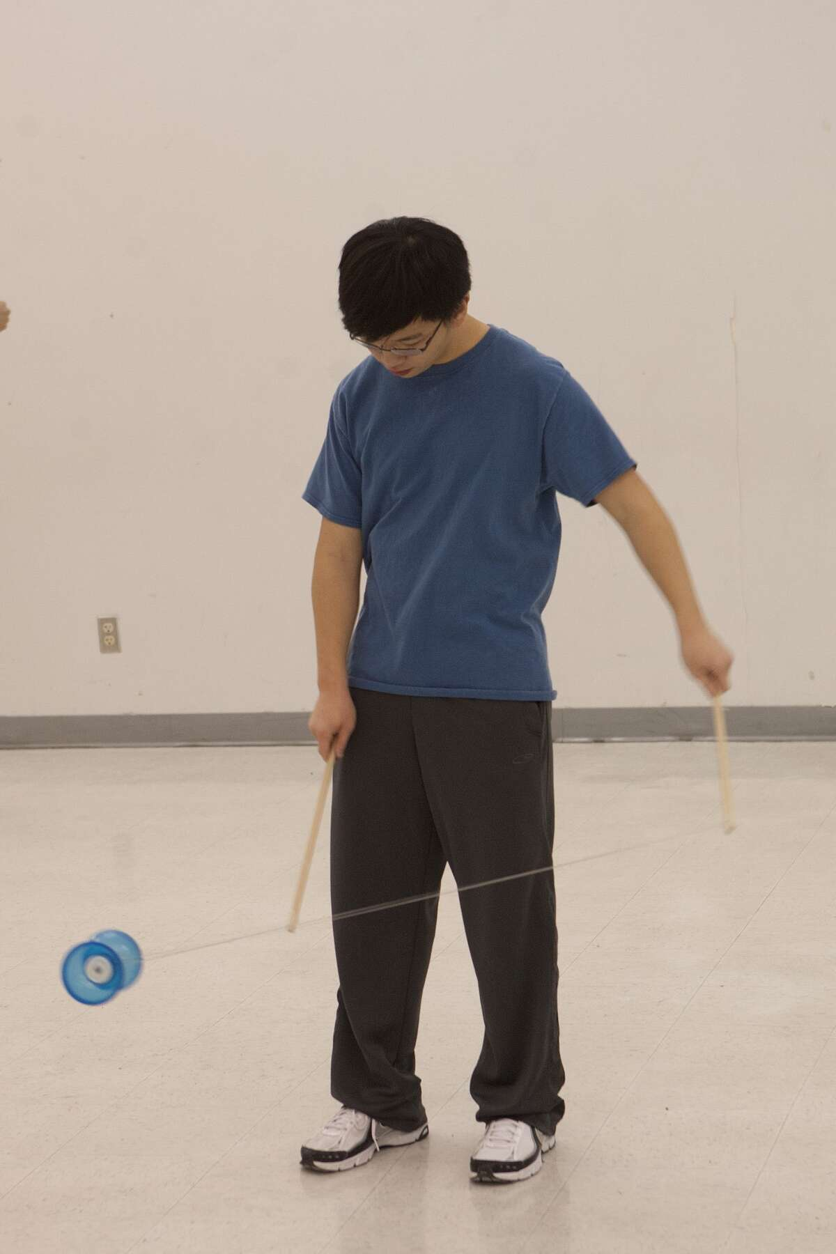 Bellaire High School junior Ruizhe Wang will perform at the show with a Chinese yo-yo, which involves using two sticks.