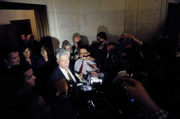 Senate Majority Leader Dean Skelos talks to members of the media outside his office following a meeting of Senate Republican on Monday, Nov. 17, 2014, in Albany, N.Y.   (Paul Buckowski / Times Union) Photo: Paul Buckowski, Albany Times Union / 00029519A