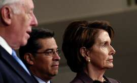 House Minority Leader Nancy Pelosi of San Francisco, right, and Rep. Xavier Becerra, D-Los Angeles, center, listen as House Minority Whip Steny Hoyer of Maryland speaks during a news conference in Washington on Tuesday.